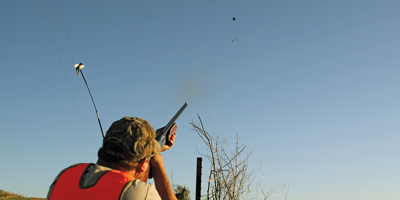Hunter Shooting at Flying Dove